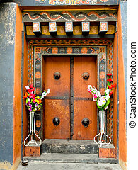 Painted and decorated wooden door in Bhutan - Beautifully...