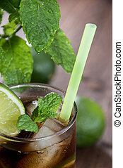 Fresh made Cocktail (Cuba Libre) on wooden background
