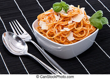 Portion of spaghetti with silverware - Portion of spaghetti...