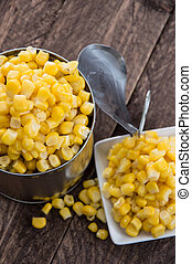 Canned Corn on wooden background