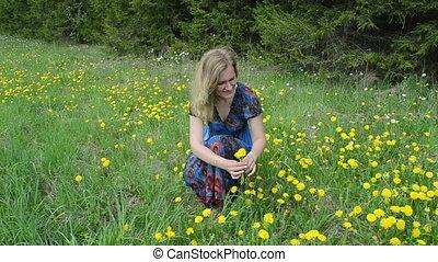 woman pick flowers - Blond woman in blue dress pick...