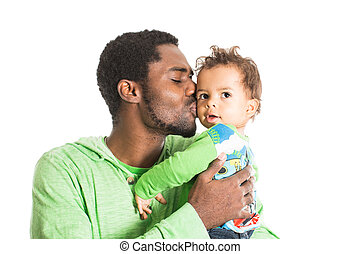 Happy black father and baby boy cuddling on isolated white...
