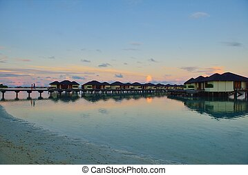 tropical water home villas resort on Maldives island at...