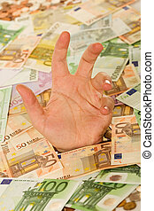 Drowning in debt business concept - Man hand reaching out...