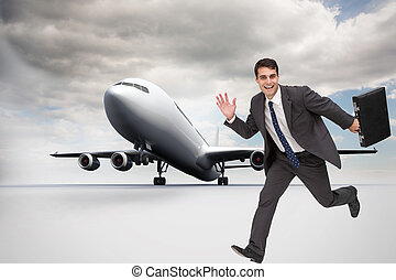 Composite image of smiling businessman in a hury - Composite...