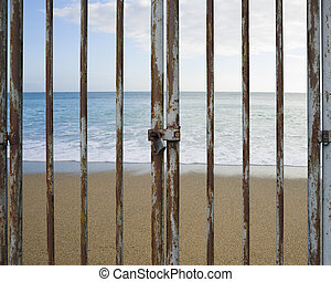 Rusty locked door with beach ocean and sky