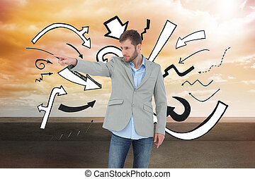 Composite image of trendy model pointing to something