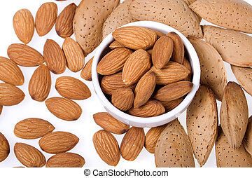 Almonds - Almond shells and cores on white background