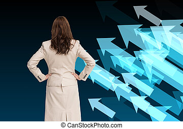 Composite image of businesswoman standing back to camera...