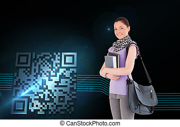 Composite image of attractive student holding books and her...