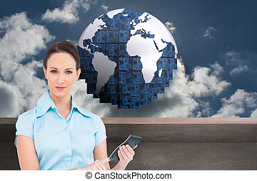 Composite image of serious classy businesswoman using...