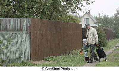 Grandpa and grandson coming into gate. - Grandpa and his...