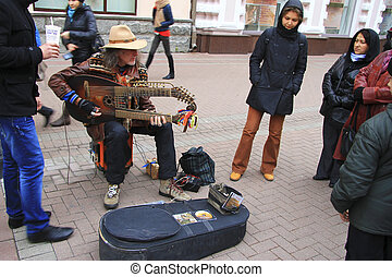 Street musician playing on the Arbat street Moscow