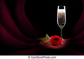 champagne glass on black and red silk with flower - luxury...