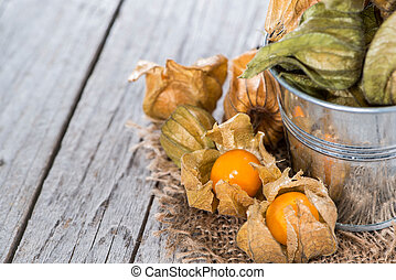 Physalis Fruits (macro shot) on vintage wooden background