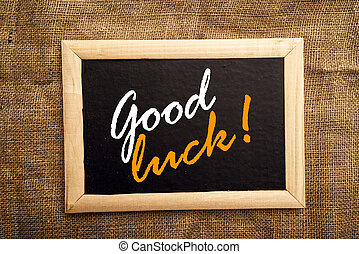 Good luck message on black board