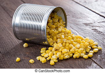 Corn on wooden background - Canned Corn on wooden background