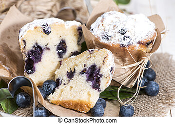 Halved Blueberry Muffin with fresh fruits