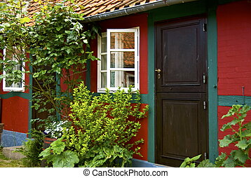 Half-timbered house - A small danish town house with lush...