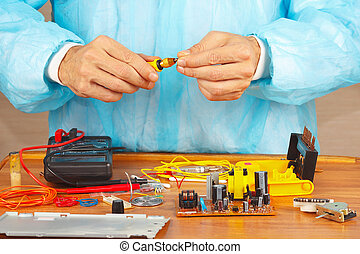 Hands service engineer of electronic equipment with...