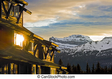 Buildings in the Mountains at Sunrise