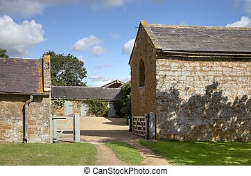 Cotswold farmyard and barns, Compton Scorpion, Warwickshire,...