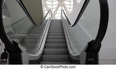 Grey escalator goes down in mall