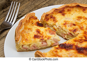 Quiche lorraine slice - Portion of cheese and bacon flan cut...