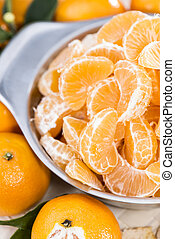Fresh Tangerine Pieces - Fresh Tangerines in a bowl close-up...