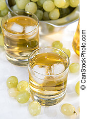 Grape Juice in a glass with fresh fruits
