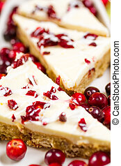 Cranberry bliss bar made with chunks of white chocolate and...