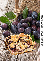 Plum Cake with fruits in the background - Plum Cake on a...