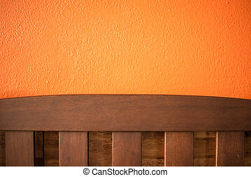 Backrest chair on the orange background in cafe.