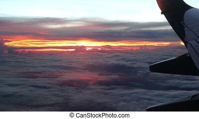 Sunset outside flying jet plane