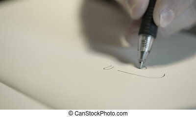 Hand drawing with a pen - Close-up of hand drawing a cartoon...