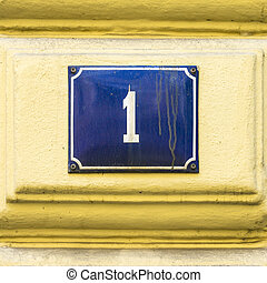 Number 1 - Enameled house number one White lettering on a...