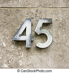 Number 45 - weathered house number forty five. Two separate...