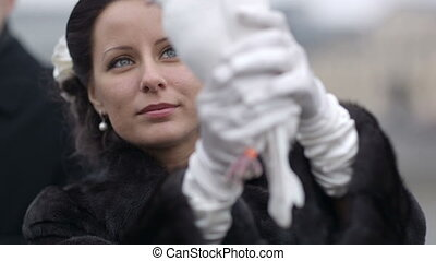 Bride with pigeon. - Bride with white wedding pigeon being...