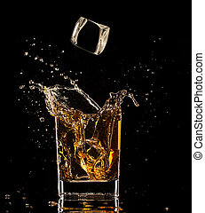 Splashing whiskey - Isolated shot of whiskey with splash on...