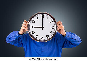 Time to Work - Businessman holding clock, time to work.