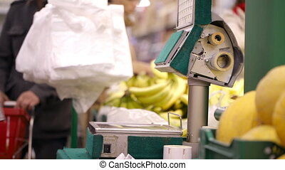 Weighing bananas in the shop.