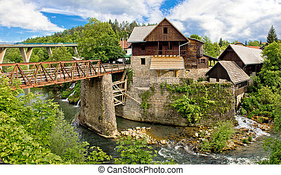 Village of Rastoke river canyon and stone architecture,...