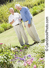 Two senior men in a flower garden