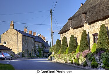 Broad Campden, Cotswolds - Clipped topiary outside thatched...
