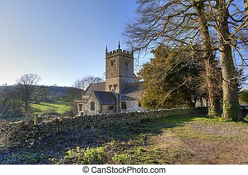 Cotswold church in winter, Gloucestershire, England.