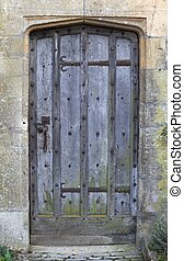 Cotswold door - Old studded oak door set into Cotswold stone...
