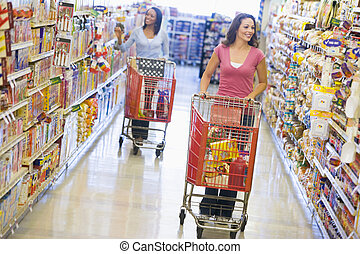 Two women shopping at a grocery store