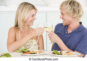 Young Couple Enjoying meal,mealtime With A Glass Of Wine