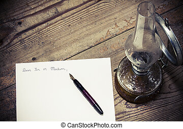 Old fashioned letter with a pen and lamp
