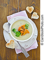 Creamy mushroom soup with fresh chanterelles and toast